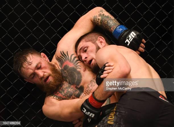 Las Vegas United States 6 October 2018 Conor McGregor left and Khabib Nurmagomedov in their UFC lightweight championship fight during UFC 229 at...