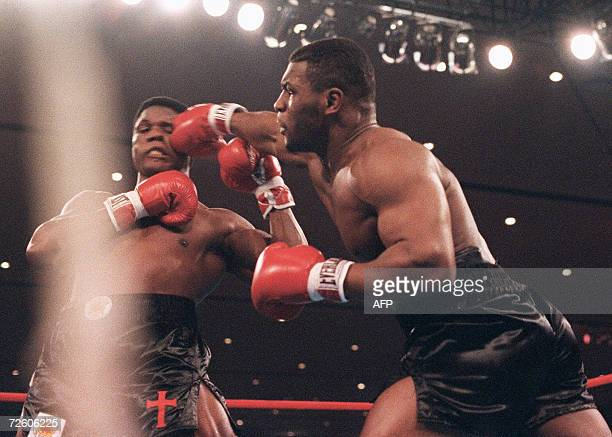 A file picture taken 22 November 1986 in Las Vegas shows Mike Tyson fighting heavyweight champion Trevor Berbick to become the youngest heavyweight...