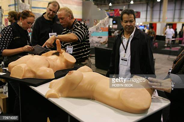 A passerby test the feel of a part of a Real Doll at the Real Doll display booth at the AVN Adult Entertainment Expo in Las Vegas Nevada 10 January...