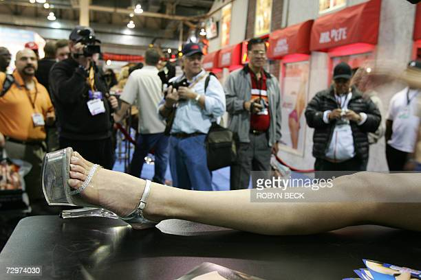 A porn actress preforms for attendees at a pornographic website booth at the AVN Adult Entertainment Expo in Las Vegas Nevada 10 January 2007 The AVN...