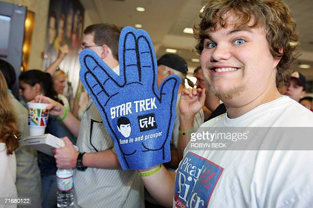 A Star Trek fan flashes the Vulcan 'Live Long and Prosper' hand sign as he waits to get into to hear actors from the famed television show speak on...