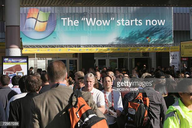 Las Vegas, UNITED STATES: Attendees walk under an advertisement for Microsoft's Windows Vista outside the Las Vegas Convention Center during the 2007...