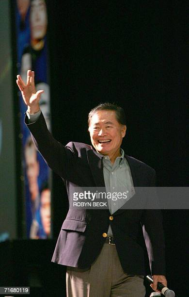 """Las Vegas, UNITED STATES: George Takei who portrayed Mr Sulu, greets fans with the """"Live Long and Prosper"""" Vulcan hand sign at the Star Trek..."""