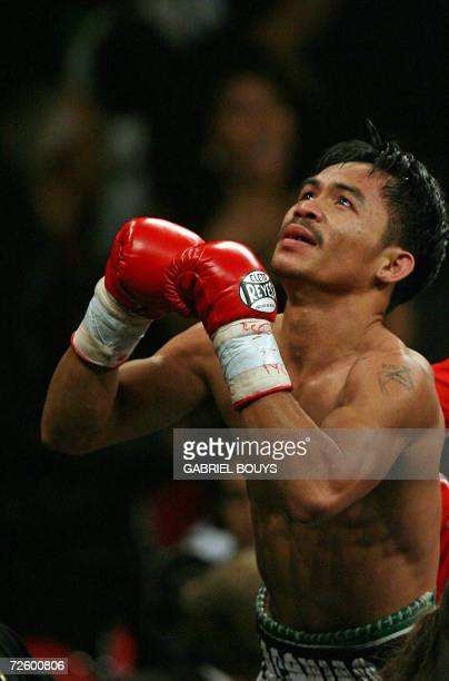Manny Pacquiao of the Philippines celebrates after knocking out Erik Morales of Mexico during their WBC International Super Featherweight boxing...