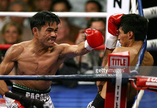 Manny Pacquiao of the Philippines fights Erik Morales of Mexico during their WBC International Super Featherweight boxing title match in Las Vegas...
