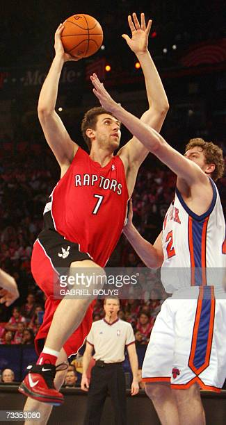 Sophomore Team Rooster 's David Lee fights for the ball with Rookie Team Rooster's Italian Andrea Bargnani during the All Star Rookie Challenge 16...