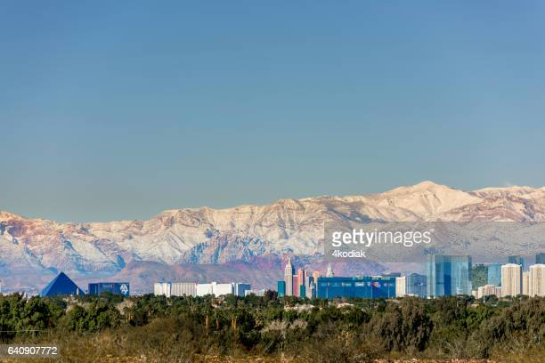 las vegas with snow capped mountain - mt charleston stock photos and pictures