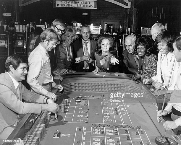 Picture shows people gambling in a Las Vegas casino A woman is shown throwing the dice at a craps table with people watching Undated photo circa 1960s