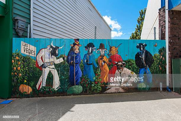 'Las Vegies' creative painting on tall wooden fence displaying Elvis and some local town heroes as bulls Hence the town's name Bulls in...