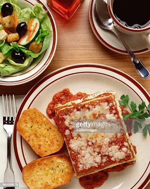 Lasagna , garlic bread and salad