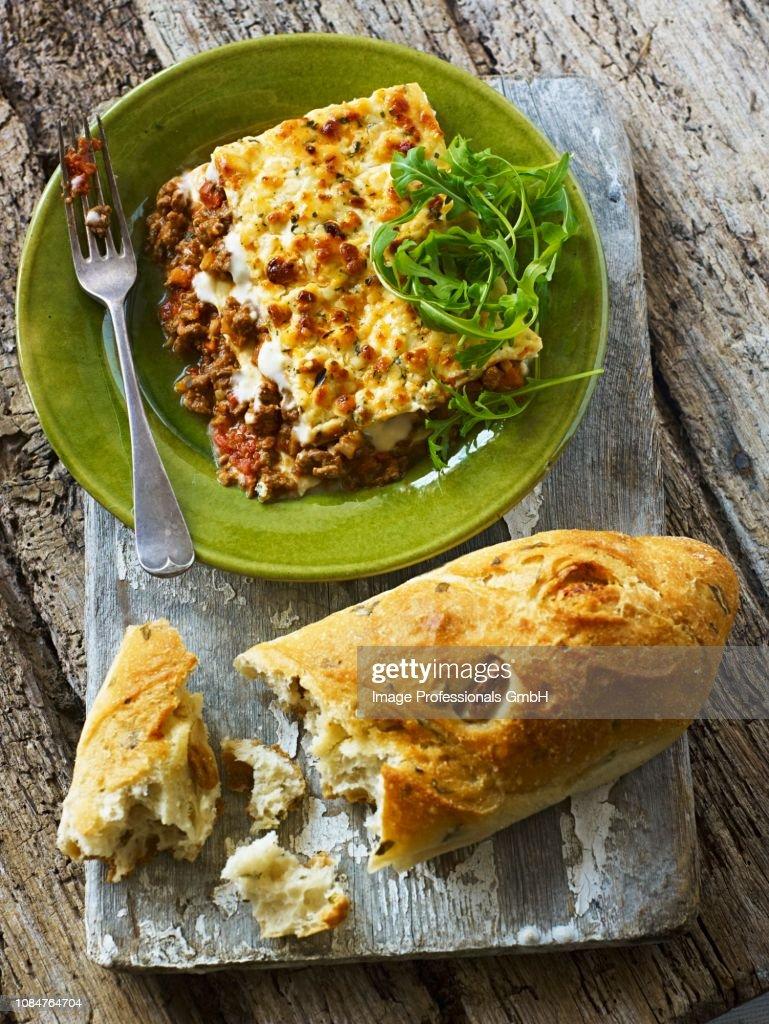 Lasagne with white bread : Stock Photo
