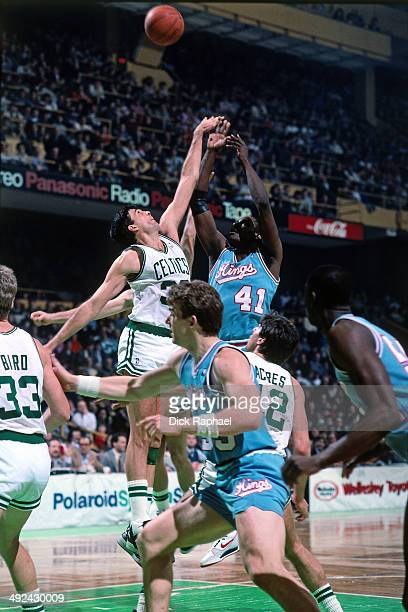 LaSalle Thompson of the Sacramento Kings shoots against Kevin McHale of the Boston Celtics during a game played in 1988 at the Boston Garden in...