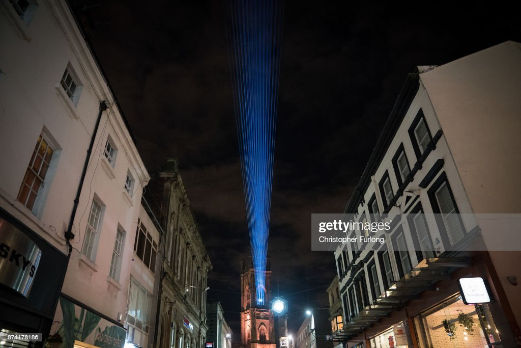 A laser beam illuminates the sky as businesses in Liverpool switch on their Christmas lights and window displays in the hope of an early boost to sales during the festive period on November 14, 2017 in Liverpool, England.