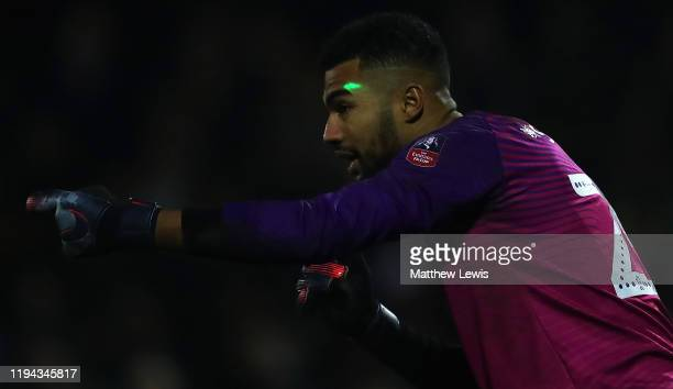 Laser beam is shown onto Robert Sanchez of Rochdale's face from the home supporters during the FA Cup Second Round Replay match between Boston United...
