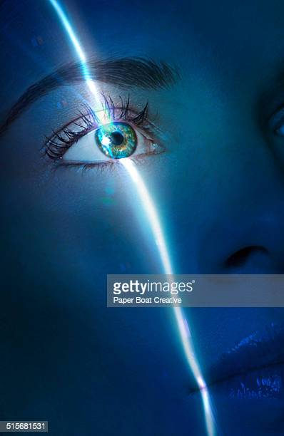 laser beam passing through the eye of a lady - medical laser stock photos and pictures