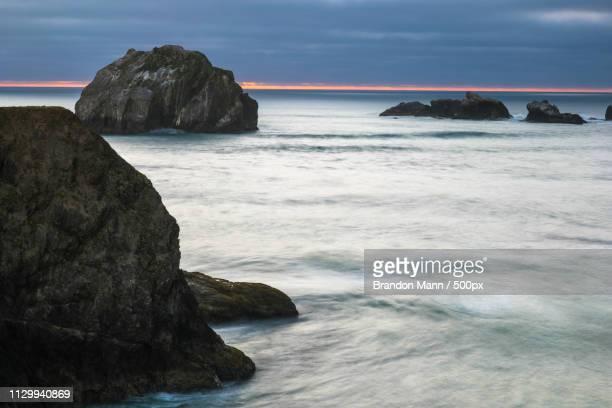 laser cut sunset - philosophie stock-fotos und bilder