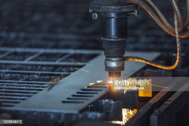 cnc laser cutting of metal, modern industrial technology. small depth of field. - laser stock pictures, royalty-free photos & images