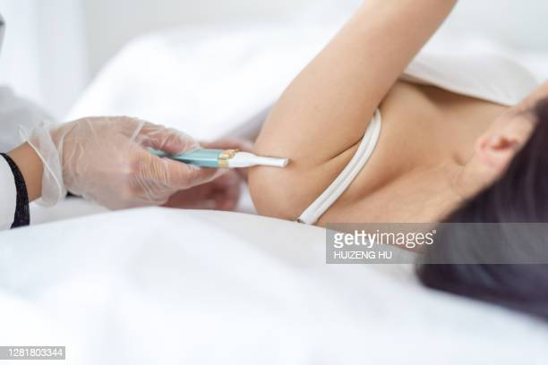 laser epilation treatment. young woman in a beauty salon - waxing hair removal stock pictures, royalty-free photos & images