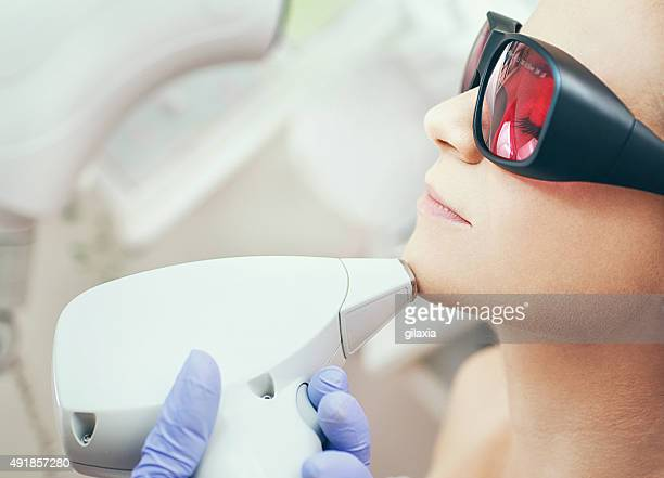 laser hair removal. - medical laser stock photos and pictures