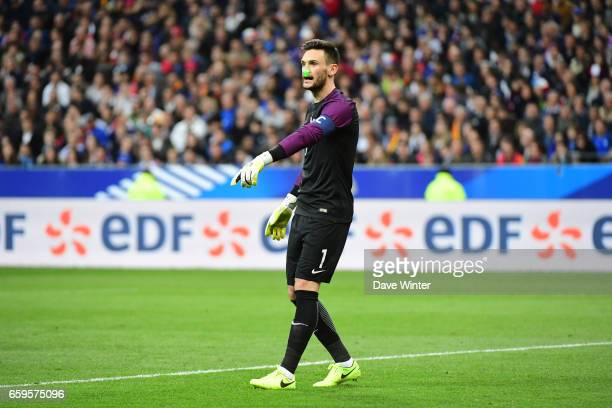 A laser is shone on the face of Hugo Lloris of France during the friendly match between France and Spain at Stade de France on March 28 2017 in Paris...