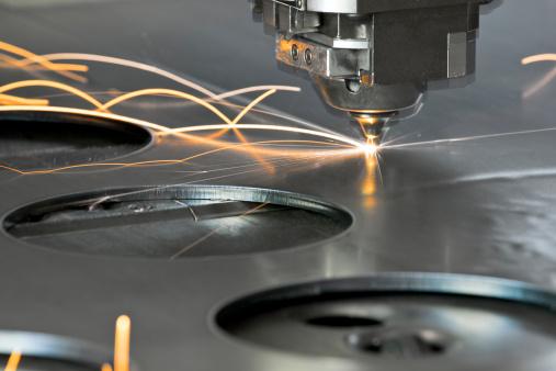 Laser metal cutting manufacturing tool in operation 154925535