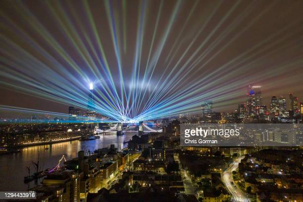 Laser show replaces the usual New Years Eve firework display by Tower Bridge due to the Covid 19 restrictions on January 01,2021 in London, England.
