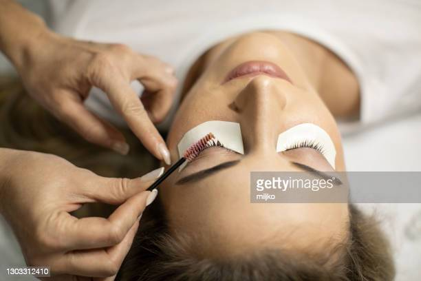 lash lamination treatment in the salon - picking up stock pictures, royalty-free photos & images