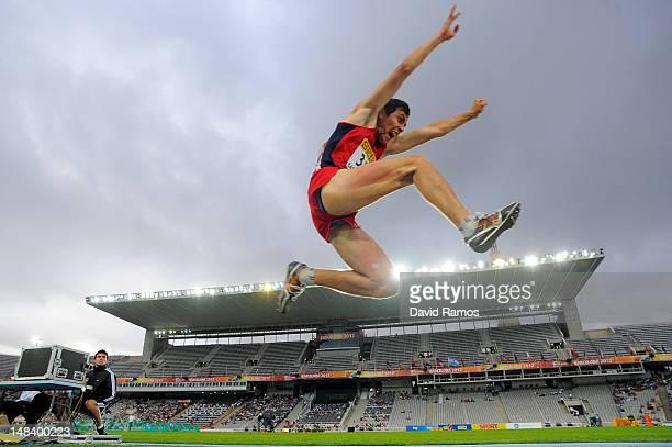 Lasha Gulelauri of Georgia competes in the Men's Triple Jump Final on day six of the 14th IAAF World Junior Championships at Estadi Olimpic Lluis...