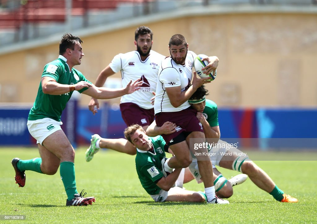 Lasha Jaiani of Georgia crashes through the tackled of Caelan Doris of Ireland during the World Rugby U20 Championship 9th Place Playoff match between Ireland and Georgia at Mikheil Meskhi Stadium on June 18, 2017 in Tbilisi, Georgia.