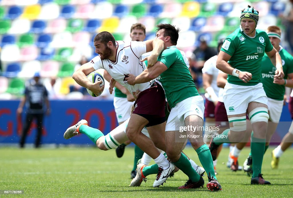 Lasha Jaiani of Georgia is tackled by John Foley and Ronan Kelleher of Ireland during the World Rugby U20 Championship 9th Place Playoff match between Ireland and Georgia at Mikheil Meskhi Stadium on June 18, 2017 in Tbilisi, Georgia.