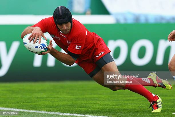 Lasha Khmaladze of Georgia goes over to score his try during the IRB 2011 Rugby World Cup Pool B match between Argentina and Georgia at Arena...