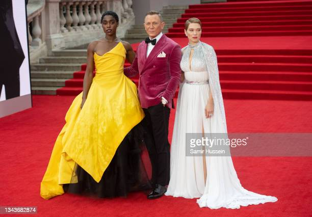 """Lashana Lynch, Daniel Craig, and Léa Seydoux attend the """"No Time To Die"""" World Premiere at Royal Albert Hall on September 28, 2021 in London, England."""