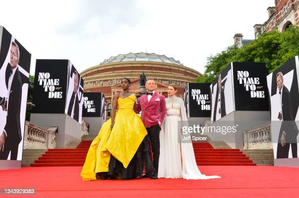 """Lashana Lynch, Daniel Craig and Léa Seydoux attend the World Premiere of """"NO TIME TO DIE"""" at the Royal Albert Hall on September 28, 2021 in London,..."""