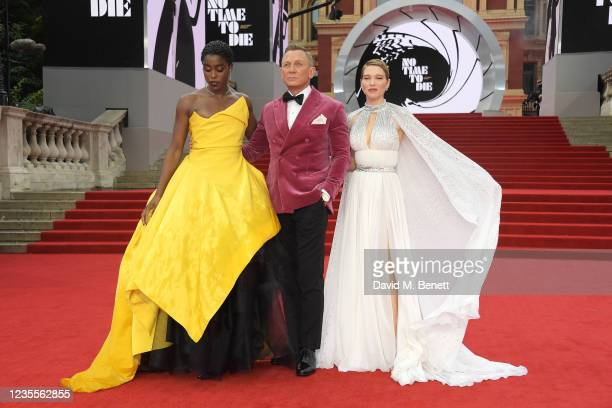 """Lashana Lynch, Daniel Craig and Lea Seydoux attend the World Premiere of """"No Time To Die"""" at the Royal Albert Hall on September 28, 2021 in London,..."""