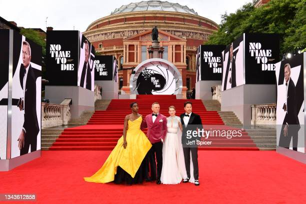 """Lashana Lynch, Daniel Craig, Léa Seydoux, and Cary Joji Fukunga attend the World Premiere of """"NO TIME TO DIE"""" at the Royal Albert Hall on September..."""