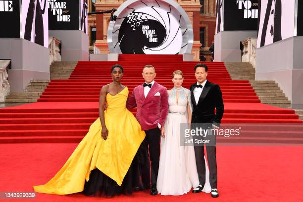 """Lashana Lynch, Daniel Craig, Léa Seydoux, and Director Cary Joji Fukunga attend the World Premiere of """"NO TIME TO DIE"""" at the Royal Albert Hall on..."""