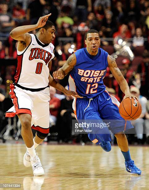 La'Shard Anderson of the Boise State Broncos brings the ball up the court against Oscar Bellfield of the UNLV Rebels during their game at The Orleans...