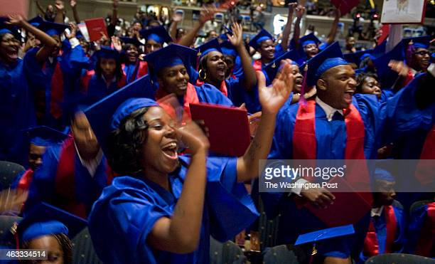 Lashaunta Davis applauds members of her fellow graduating class where FLOTUS Michelle Obama gave the commencement speech at the graduation of...