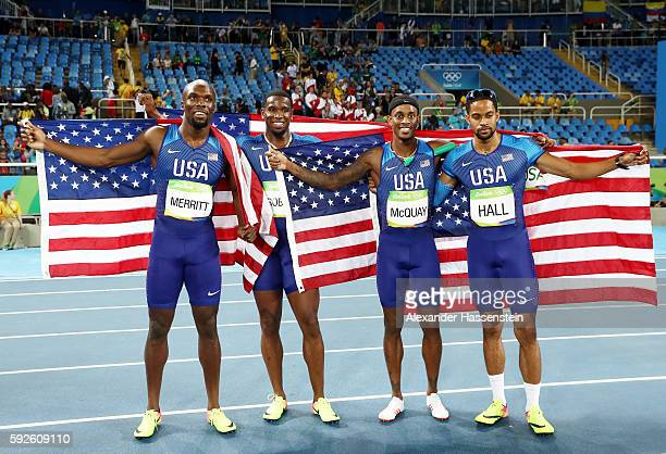Lashawn Merritt, Gil Roberts, Tony McQuay and Arman Hall of the United States react after winning gold in the Men's 4 x 400 meter Relay on Day 15 of...
