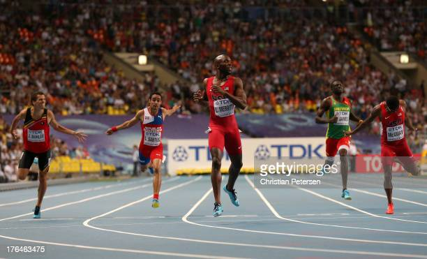 LaShawn Merritt of the United States crosses the line ahead of Jonathan Borlee of Belgium Luguelin Santos of the Dominican Republic Kirani James of...