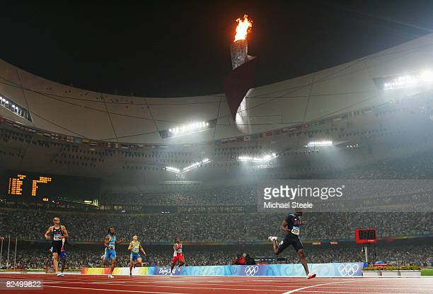 Lashawn Merritt of the United States crosses the line and celebrates winning the Men's 400m Final and the gold medal held at the National Stadium...