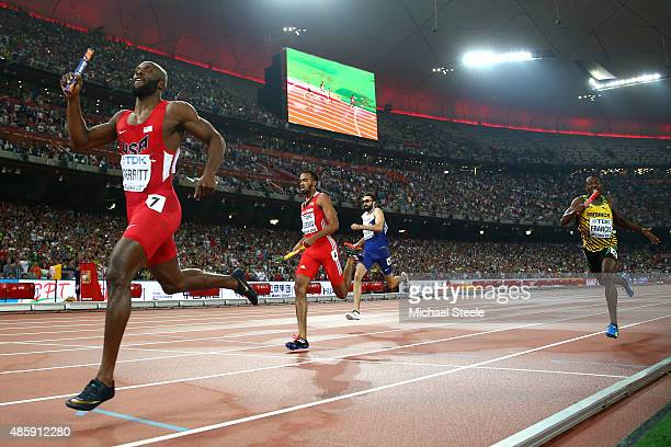 Lashawn Merritt of the United States leads Martyn Rooney of Great Britain and Machel Cedenio of Trinidad and Tobago in the Men's 4x400 Relay Final...