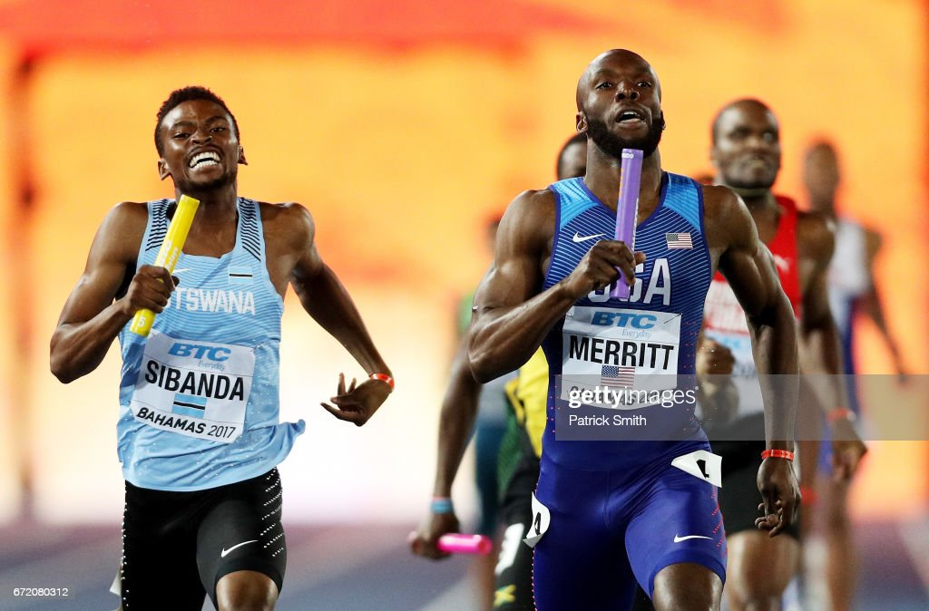 LaShawn Merritt of the USA and Karabo Sibanda of Botswana run to the finishline in the Men's 4x400 Metres Relay Final during the IAAF/BTC World Relays Bahamas 2017 at Thomas Robinson Stadium on April 23, 2017 in Nassau, Bahamas.