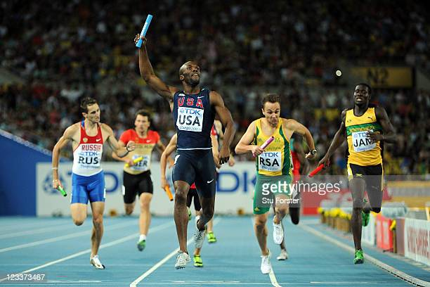 LaShawn Merritt of the USA crosses the finish line ahead of L.J. Van Zyl of South Africa to claim victory in the men's 4x400 metres relay final...