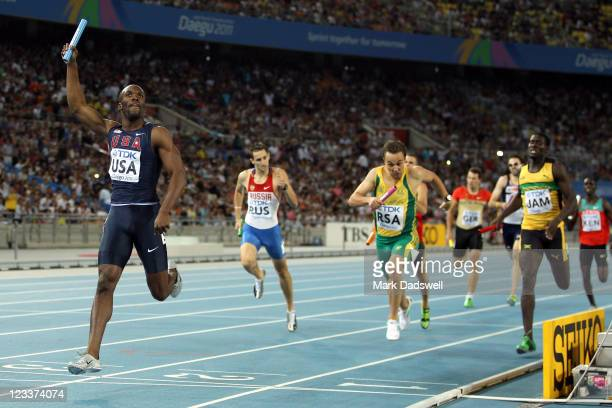 LaShawn Merritt of the USA crosses the finish line ahead of L.J. Van Zyl of South Africa and Leford Green of Jamaica to claim victory in the men's...