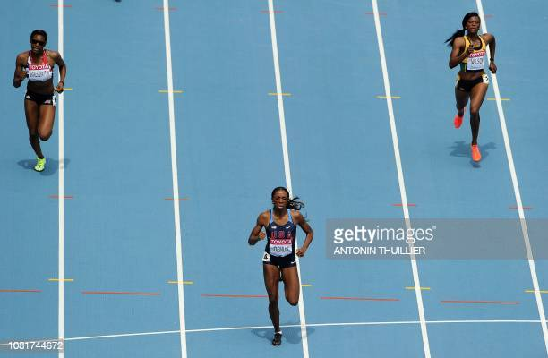 US Lashinda Demus leads ahead of Britain's Perri ShakesDrayton andJamaica's Nickiesha Wilson during the women's 400 metres hurdles heats at the...