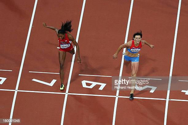 Lashinda Demus of the United States and Natalya Antyukh of Russia cross the finish line in the Women's 400m Hurdles Final on Day 12 of the London...