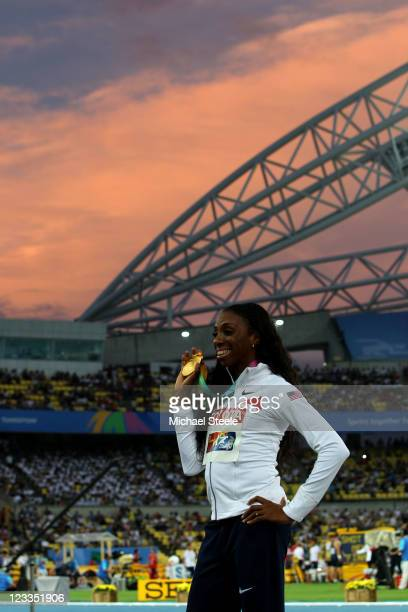 Lashinda Demus of the USA poses with the gold medal during the medal ceremony for the women's 400 metres hurdles during day seven of 13th IAAF World...