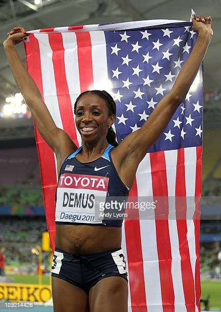 Lashinda Demus of United States celebrates with her country's flag after claiming gold in the women's 400 metres hurdles final during day six of the...