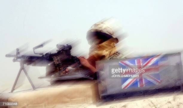 A British soldier from the Helmand Task Force provides security as a convoy transports unexploded ordnance near the Provincial Reconstruction Team's...